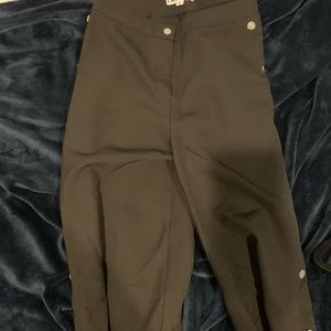 Black pants button on side